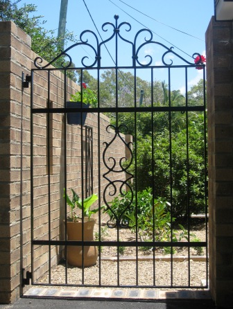 Hand forged wrought iron courtyard gate