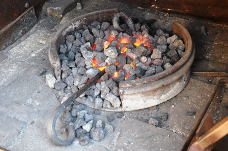 Heating the steel scrolls in the forge