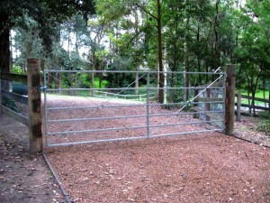 Estate gate with rabbit proof mesh overlay