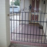 Wrought iron gate for side entrance of house