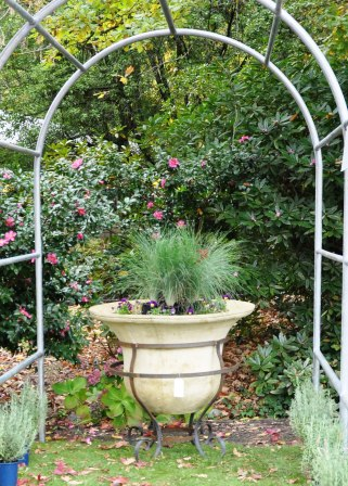 Large bell planter with wrought iron base