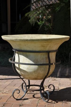 wrought iron base with large GRC bell pot