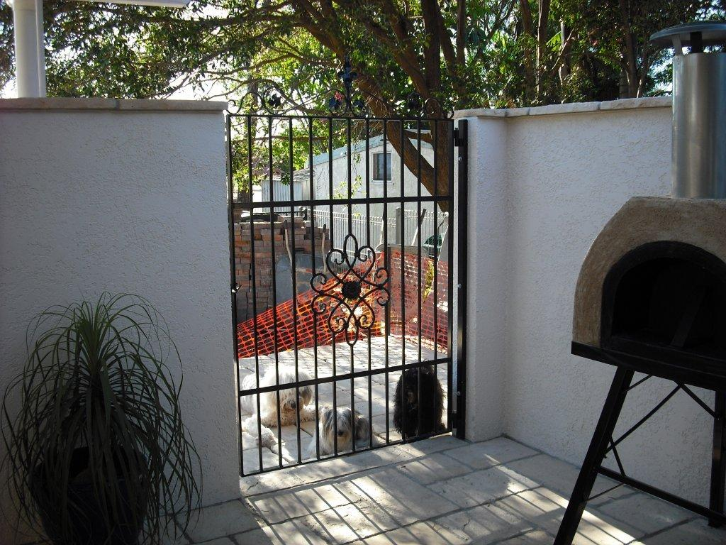 Dog friendly wrought iron courtyard gate