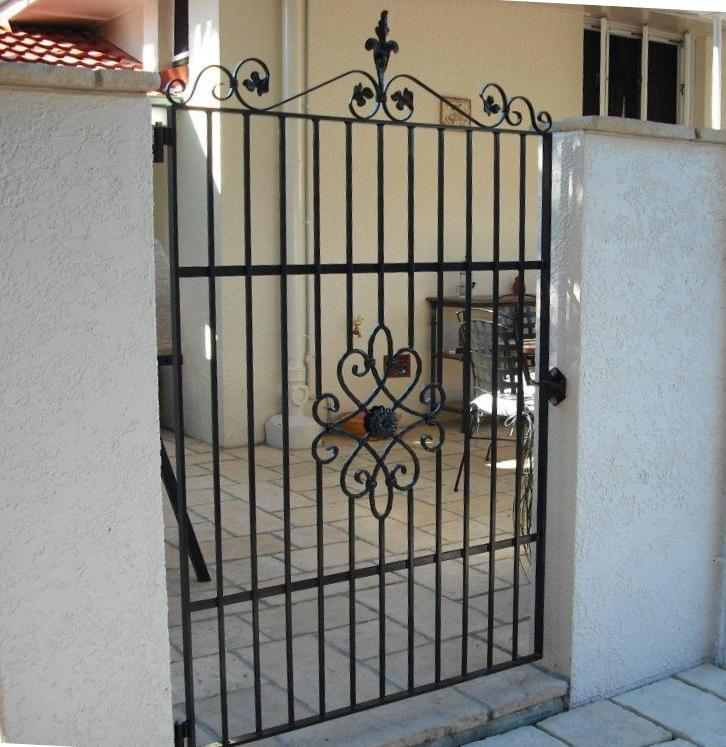 wrought iron courtyard gate with centre motif