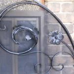 Fire screen with wrought iron detail