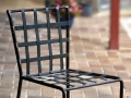 Wrought iron chair, woven