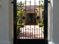 Elegant wrought iron personal access gate
