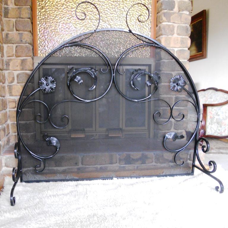Ornamental wrought iron firescreen